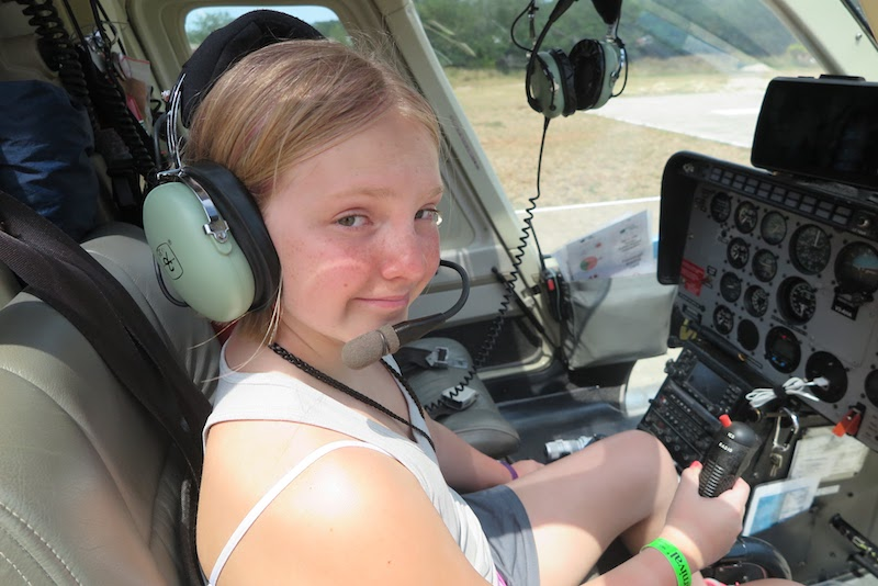 Paige in a helicopter.